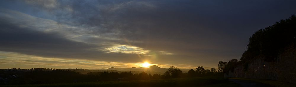 Sun rising next to mountain Hohenstaufen as seen from the old monastry